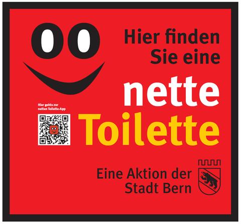"""Ein roter Aufkleber weist den Weg zur """"Netten Toilette"""""""